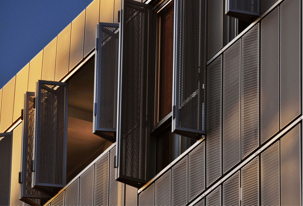 Exterior: Perforated Shutter On Housing In Montréal, By KANVA [325