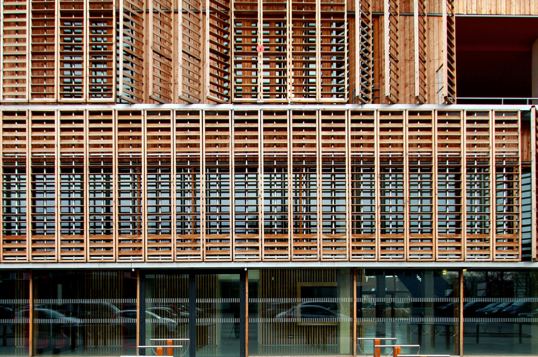 Wooden Louvered Shutters On A University Building 493