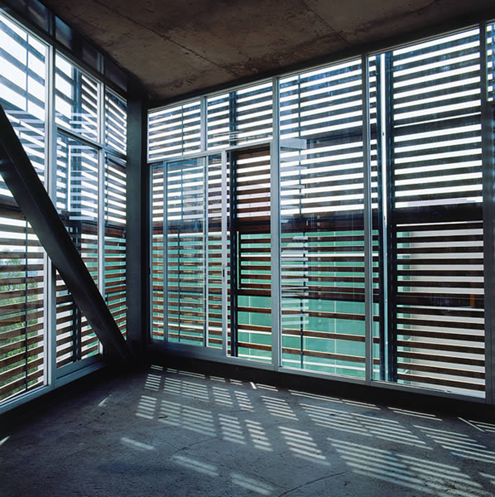 exterior wooden louvered shutters in torre cube  101