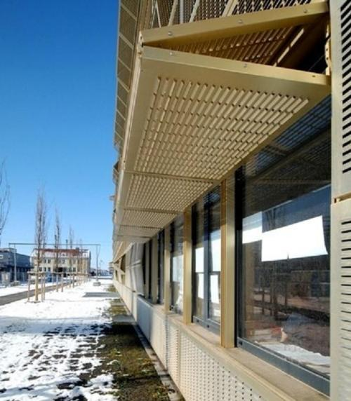 Perforated aluminium panels with tiny visors 138 filt3rs Folding facade
